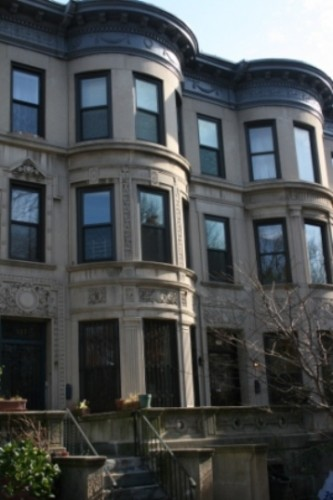 Facades stucco siding services transcend construction for Stucco facade